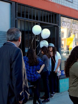 Attaching protest balloons to the crack house gates of Cedillo's office.